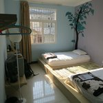En suite twin room with spacious beds on raised platform