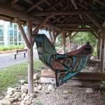 This Ravensong canoe is crafted by a local carver and sits in front of the Ravensong Pool, just