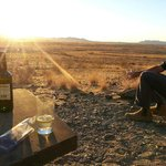 Enjoying a drink watching sunset after a game drive with Williams