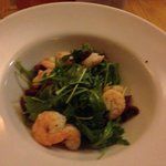 Tiger prawns with rocket and sun dried tomatoes