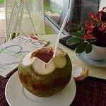 Drinking a coconut at Atsumi Raw Cafe, Rawai, Phuket