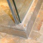 Chipped corner ledge near to glass-door