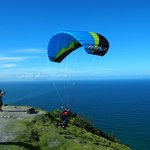 Paragliders launching from Mount Maunganui Summit Track