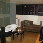 View of the duplex bathroom suite, walk in shower and chaise lounge