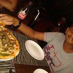 "My son enjoying the Italian veg pizza. ""Yummiest""!"
