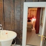 View of the bed from the en-suite bath and shower room