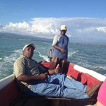Kingsley with boat captain Lando en route to the Pelican Bar