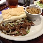 12 napkin roast beef Po boy half with dirty rice side