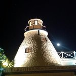 lighthouse restaurant with full moon, magic