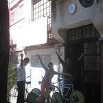 Hostel facade, group ready to ride with hostel bike rental service