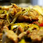 Pork with peppers and wine sauce