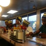The server gave them Waffle House hats; she take their picture and posted it on the wall.
