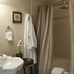 The spacious bathroom in the Ocean Dreams guest room has a jacuzzi tub and rain shower