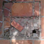 Many examples of broken paving in the busy pool areas