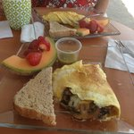 Omlette, complete with fresh fruit & salsa