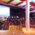 Bar seating w football game on screen