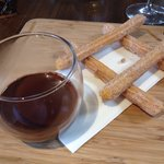 Churros with warm chocolate dipping sauce