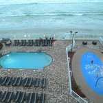 View of the pool area and beach from our room