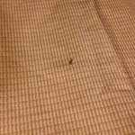 cigarette burn holes on the bedspread