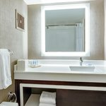 Bright bathrooms oversized backlit mirrors
