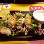 Fresh caught grilled squid with lemon garlic aioli sauce.