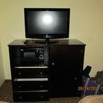 Flat screen tv, micro-wave oven, mini refrigerator.