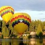 Hot air balloons viewed from deck over Cottage Lake