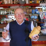 PHOTO OF MY HUSBANDS UNCLE MIKE ARCURE ENJOYING A TASTY PROSCIUTTO SANDWICH.TY