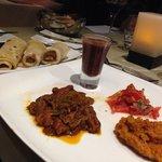 Vegan main course: veg curry, pumpkin chutney, tomato salad and red beans