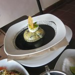 swiss cheese ball stuffed with mince and black bean mole sauce