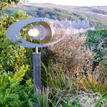The Wind Elipse Sculpture, with Manorbier Castle in the background