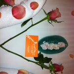 Roses and sweets on bed when hotel discovered birthday!