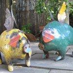 Garden art, flying pigs