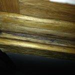 sticky crude on cabinet door beneath kitchen sink
