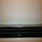 above stove wall paper peeling and dirty