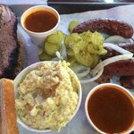The big haul - brisket, chipotle sausage, sauce, pickles, onions, bread and potato salad