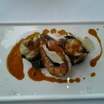 Pan fried Japanese bay scallop and king prawn with ink risotto, crustacean essence