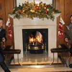 By the warm fireplace at reception.