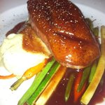Duck with calvados and blackcurrant