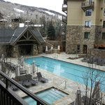 Heated pool and ski resort in background from balcony