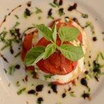 Fresh local tomato w/ our housemade mozzarella