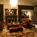 Lobby area with fireplace and Christmas tree