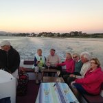 German tourists enjoying sunset dinner while cruising the Kromme River on Swan of Brisan
