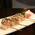 Appetizer: Deliciously warm tuna salad with spring onions on crispy rice