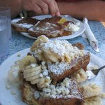 Cinnamon Roll French Toast (back) and banana-macadamia nut french toast (front) at Kihei Caffe.