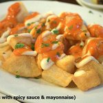 Patatas Bravas.. Fried potatoes with spicy tomato sauce & garlic mayonnaise