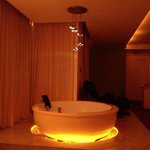 Jacuzzi in suite at night.