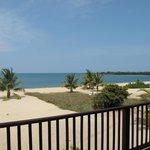 view from veranda overlooking beach and ocean