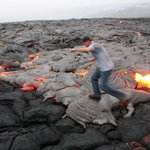 Me walking on the freshly cooled lava
