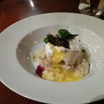 Smoked haddock and prawn risotto with a poached egg